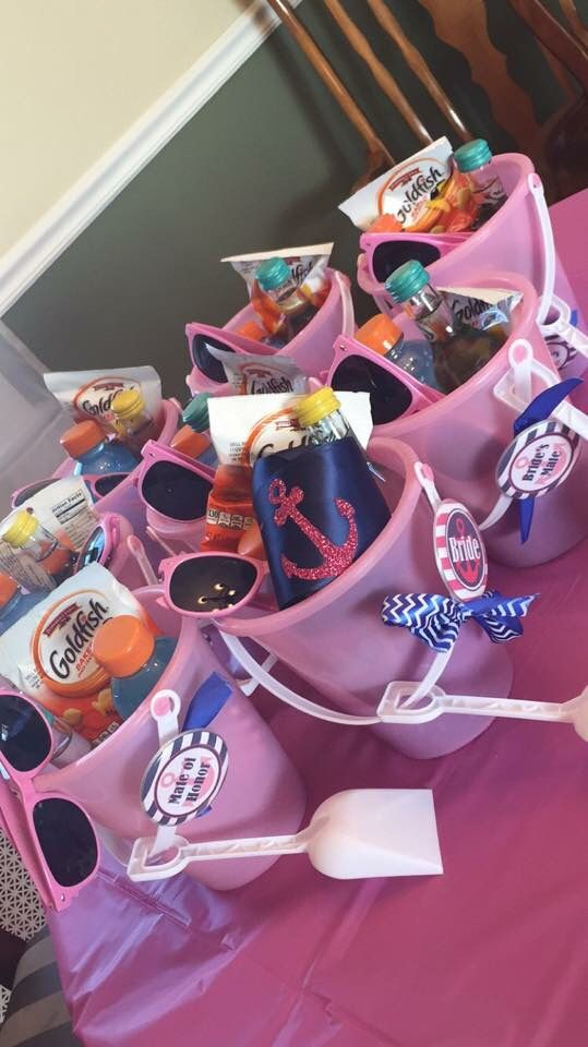 """Favors for the bridesmaids at my sisters """"Last Sail before the Veil"""" bachelorette party. Included were mini wine bottles, bottles of Gatorade which I had removed the labels from and wrapped with nautical printed duct tape, Advil packets, some snack size chocolates, gum, and bags of goldfish. Also included were pink sunglasses that I wrote """"Get Nauti"""" on the side of with a navy blue acrylic paint pen. I made the """"Bride's Mate"""" buttons myself with some supplies I found online. Huge success!!"""