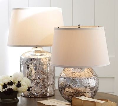 Great way to transform some Goodwill lamps: Krylon's Looking Glass spray paint, which dries into a mirror-like finish. First, spray the body of your plain glass with clean water. While the surface is wet, spray it thoroughly with Looking Glass spray paint. The water will prevent the paint from completely adhering to the surface – exactly what's required to achieve the characteristically blotchy look of genuine mercury glass. Let the paint dry overnight, and repeat the process