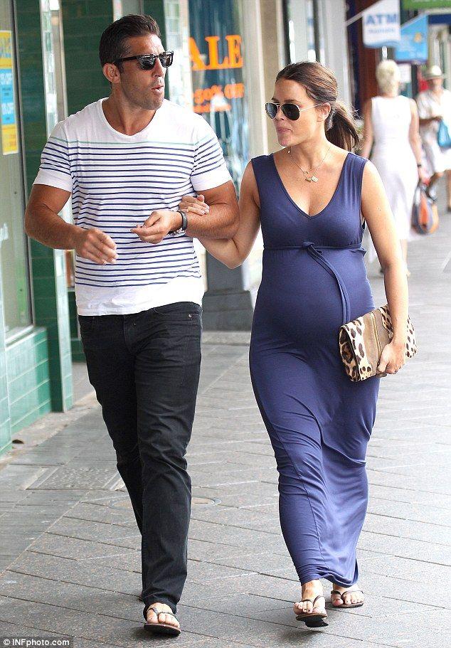 Jodi Gordon with husband Braith Anasta.. blue maxi dress - functional and fitting..