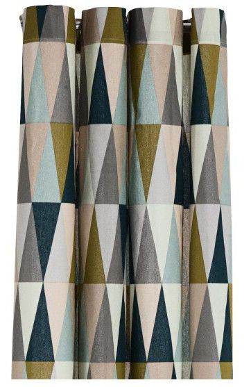 Ferm Living's renowned spear print makes its bathroom debut on this coated shower curtain — a surefire way to add style to showering.