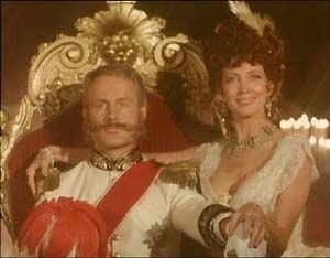 """The King of Bohemia (Wolf Kahler) and Irene Adler (Gayle Hunnicutt) pose for the fateful photograph, in """"A Scandal In Bohemia""""."""