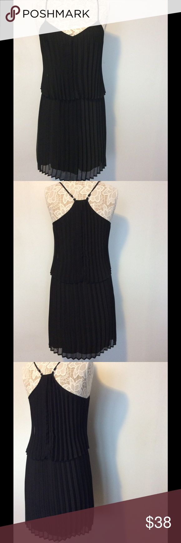 Fun black pleated evening dress by bar lll Shoulder strap and pleated, falls to your knee, very pretty, never worn, you will love the black dress. Bar III Dresses