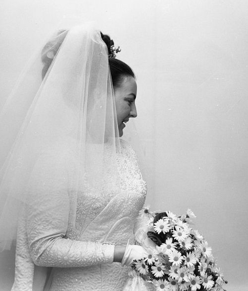 Princess Margriet of the Netherlands on her wedding day; Margriet means daisy in Dutch and the flower appears in the design of her dress fabric and in her bouquet.