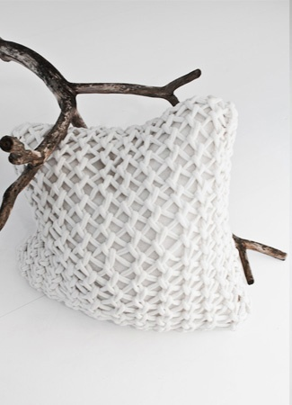 Cushion made of crocheted cotton and wool. The picture decorated with a branch. Looks soft and tender. To match with any style.