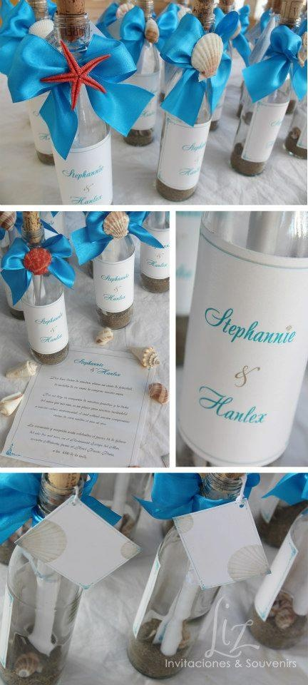 Beach - destination wedding invitations  I love it! Message in a bottle. The ribbons should be crimson, cream seashells on them.