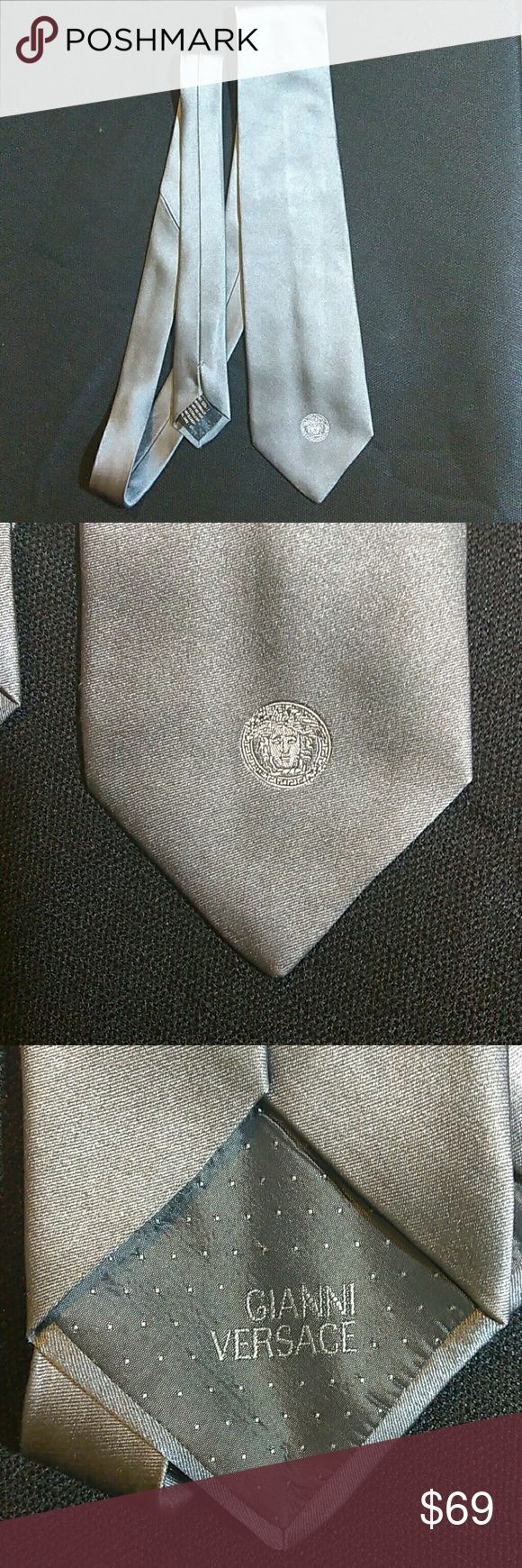 Versace Tie Authentic Versace  Silver 100% silk tie is in good condition. Thin pen mark on time but not in a noticeable spot. Price reflects pen mark. Accessories Ties