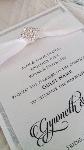 Elegant silver glitter and white wedding invitation, trimmed wirh some serious sparkling diamantes. Invite by www.PrimaDonnastationery.com.au