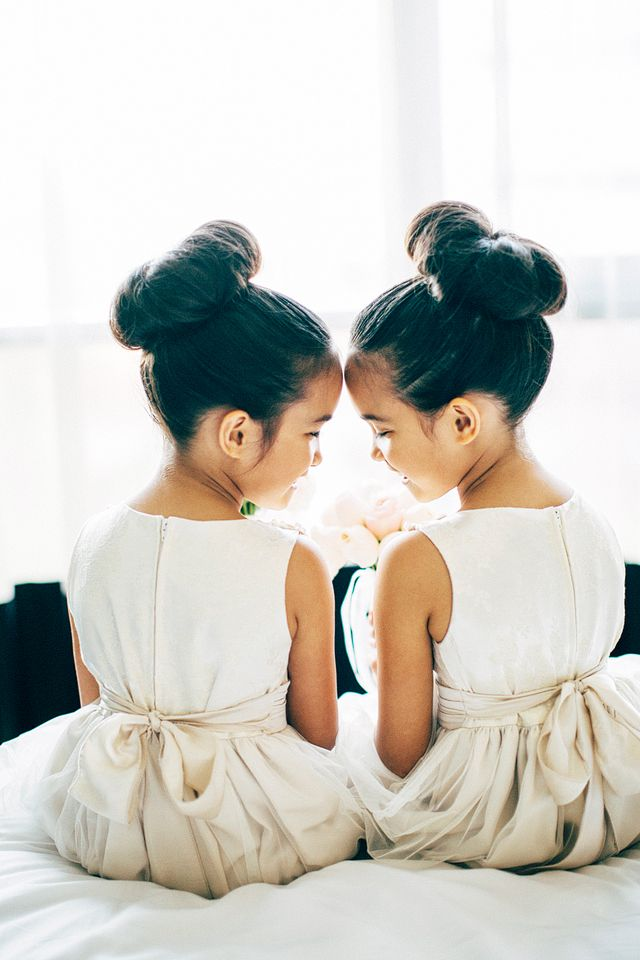 Twin flower girls with sock buns | Natasja Kremers Photography | see more on: http://burnettsboards.com/2014/09/glamorous-wedding-cutest-flower-girls/
