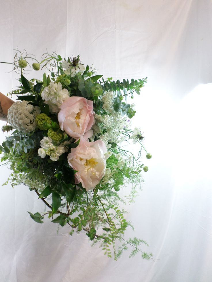 Wild garden style cascading wedding bouquet in creams, greens and blush pinks. Designed by Florist ilene, Hamilton, NZ