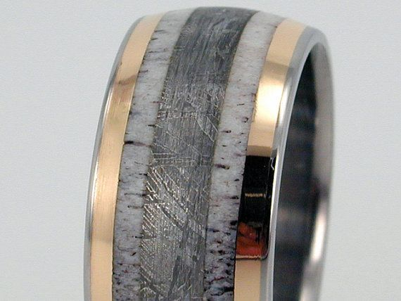 Men's wedding band or men's ring; made of titanium with gold inlay, antler inlay, and meteorite inlay. If thats not manly i dont know what is