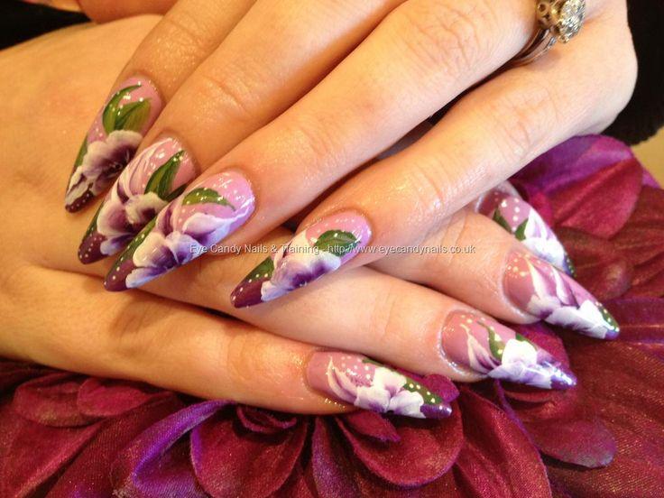 Acrylic stiletto nails with purple one stroke nail art