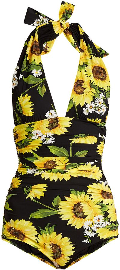 Yellow green and white sunflowers and daisies always bring an uplifting feel to Dolce & Gabbana's designs including this black halterneck swimsuit. It has a form-fitting silhouette with cleverly placed ruching to contour the waist and features a deep V-neck and open back for an ultra-feminine feel. Finish with cat-eye sunglasses and a wide-brimmed hat for a glamorous poolside look. DOLCE & GABBANA Sunflower-print halterneck swimsuit