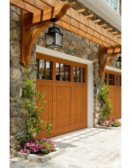 Arbor over garage door... I've done this at an old home. Makes an Enormous Difference!!