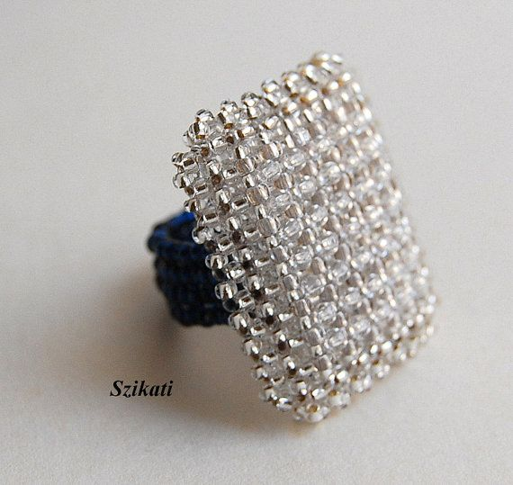 Elegant one-of-a-kind statement beadwoven seed bead cocktail ring with an absolute unique, eye-catching shape and design. It is a wonderful combination of sparkling dark blue and silver-lined clear seed beads. Theres no metal piece in it, so I calmly recommend it to anyone with metal allergy