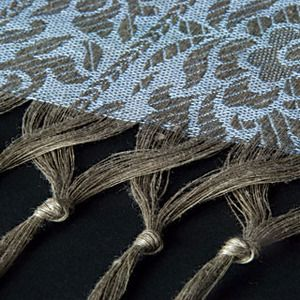 Nice idea for a finishing touch on the hem of a woven piece.