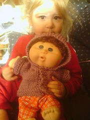 There aren't many patterns on Ravelry for the Cabbage Patch Dolls. I used to knit for my daughter's dolls many years ago. Since I still had the patterns, I'm sharing this one with everyone.