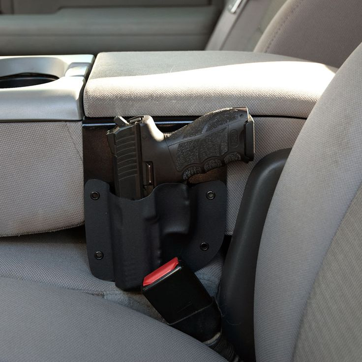 This simple but effective console holster allows you to have your pistol holstered right next to you in the center console of your vehicle for quick deployment.