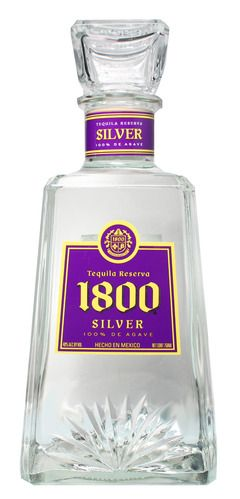 """1800 Silver Tequila teamed up with the LA Lakers in a multi-million dollar deal that included ad placement at the Staples Center and the special edition bottles to be on the shelves in the Los Angeles area in early 2010. The commemorative bottle swaps out the brand's traditional blue and silver label for the Lakers purple and gold. 100% de Agave, it has an exceptionally clean, silky smooth taste. Fragrant liquorice comes to start; not as subtle as Patron but there's a tender """"middle"""" to 1800"""