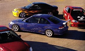 1999 Honda Civic Si Challenge cars from the magazines of Sport Compact Car (blue), Car & Driver (red), Popular Mechanics (flamed), and Super Street (red/ nuked).  I really loved reading the various magazines when these cars were being built (all the way back in 1999).  The article with this picture is a fun read as well via CarAndDriver.com