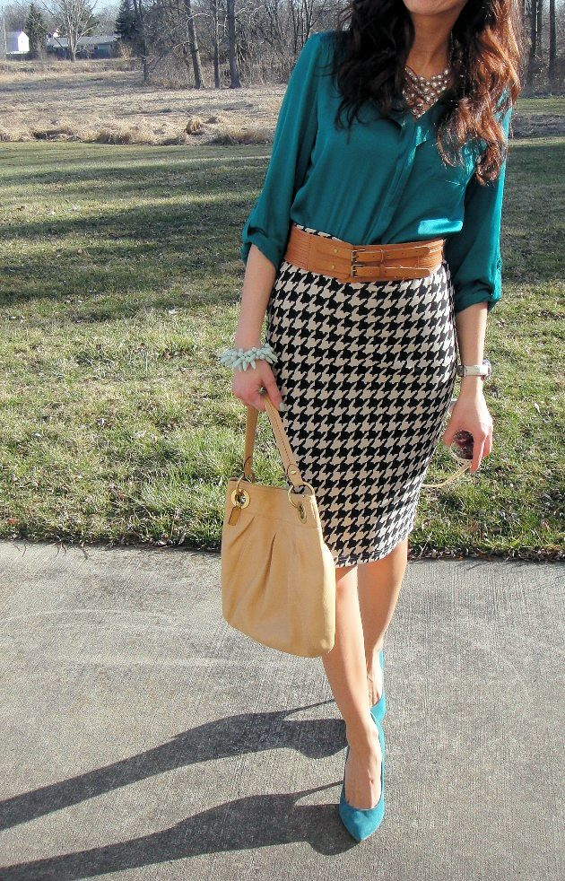 green blouse with houndstooth winter skirt; paired with thick tan belt, big necklace and nude pumps