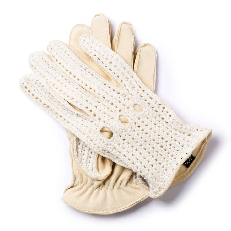 S.M.55 GENTLEMAN DRIVER COLLECTION   These driving gloves were worn by Sir Stirling Moss, the British Formula 1 driver who recorded his first victory in 1955 in the Italian Mille Miglia race. The backhand side is hand-crocheted pure wool. The palm is soft but strong deerskin. The elasticated wrist hugs the arm, but remains comfortable. We have kept the distinctive feature of Sir Sterling's gloves, often overlooked in replicas: there are just three knuckle vents on the backhand side…