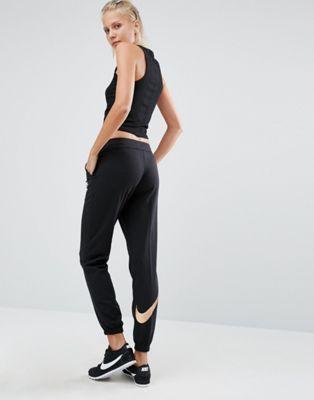 Pantalones de chándal en negro de corte estándar con logo metalizado Pantsin de Nike