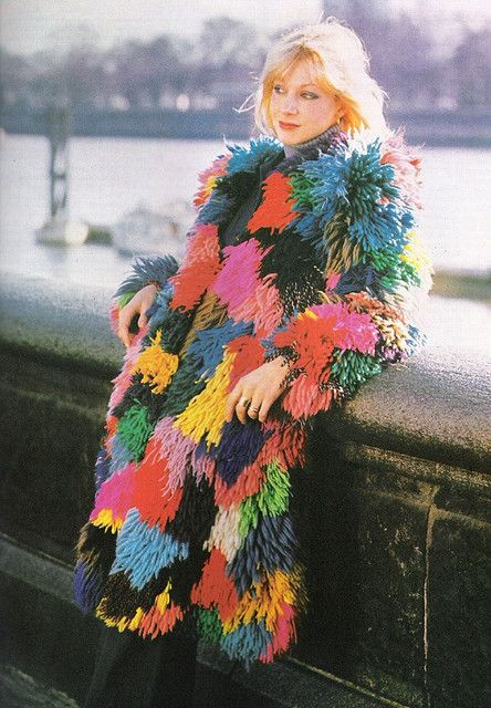 A coat of many muppets: vintage fringe patchwork - crochet base with fringed yarn (looped through and knotted).
