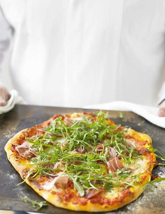 Home-made pizza is a great dish to add to your repertoire. It's easy to do and it seems everyone loves pizza! This pizza has a delicious prosciutto and rocket topping that you literally throw on the pizza as it comes out hot from the oven.