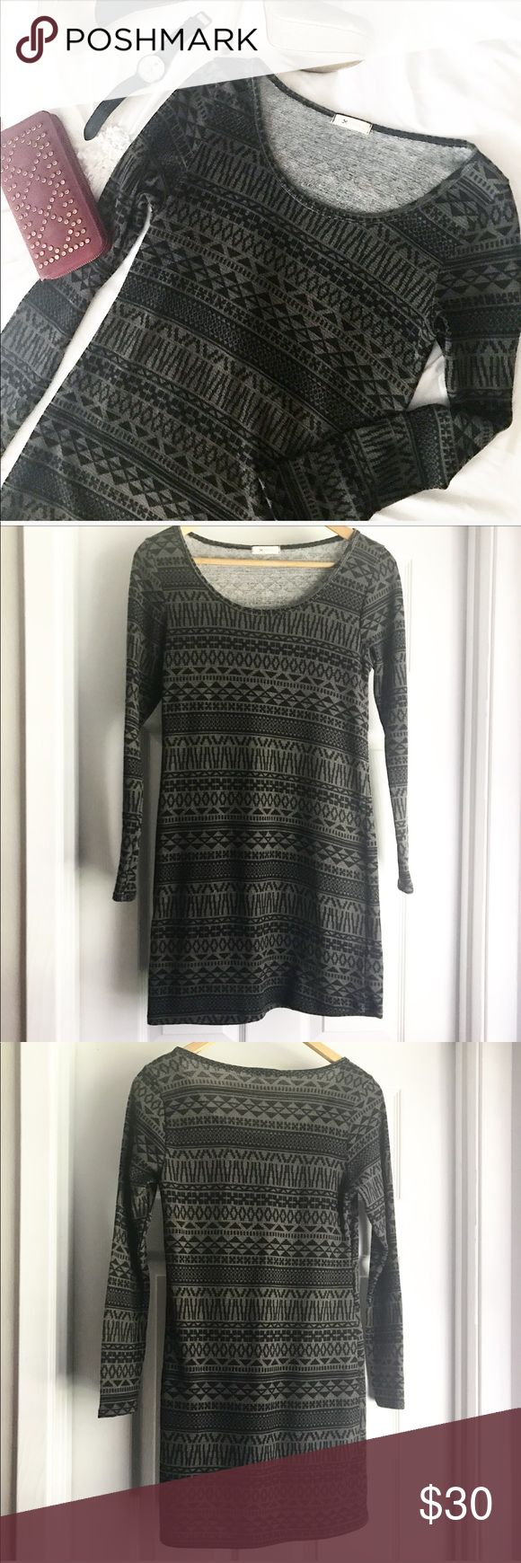 Everly Aztec Sweater Dress This gorgeous piece couldn't be more perfect for the transition into the upcoming fall and winter seasons! Pair it with boots, a vest, or a bright scarf for a trendy look! Black and gray Aztec pattern and bodycon style fit! Excellent condition! Everly Dresses Long Sleeve
