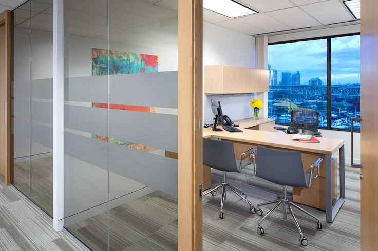 SSDG Interiors Inc.   workplace executive office: Financial Institution. Bright and modern interior design of an office in Vancouver with wood office desk, wood frame & glass office walls with graphic film, and grey carpet tile.