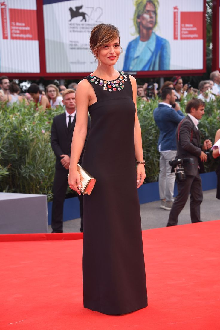 Actress Valeria Bilello wearing a Fendi dress with golden clutch at the 72nd Venice Film Festival opening ceremony
