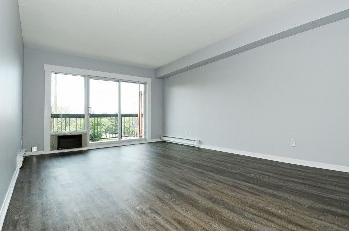 **HOT NEW LISTING**301-158C McArthur! A short walk to the Rideau River from this 2 bed, 1 bath 1012 sq ft condo which includes 1 underground parking. Nicely renovated with new flooring throughout, updated cabinets and counters in the kitchen and an updated bathroom. Visit www.JohnDonovanProperties.com or www.301-158cMcarthur.com