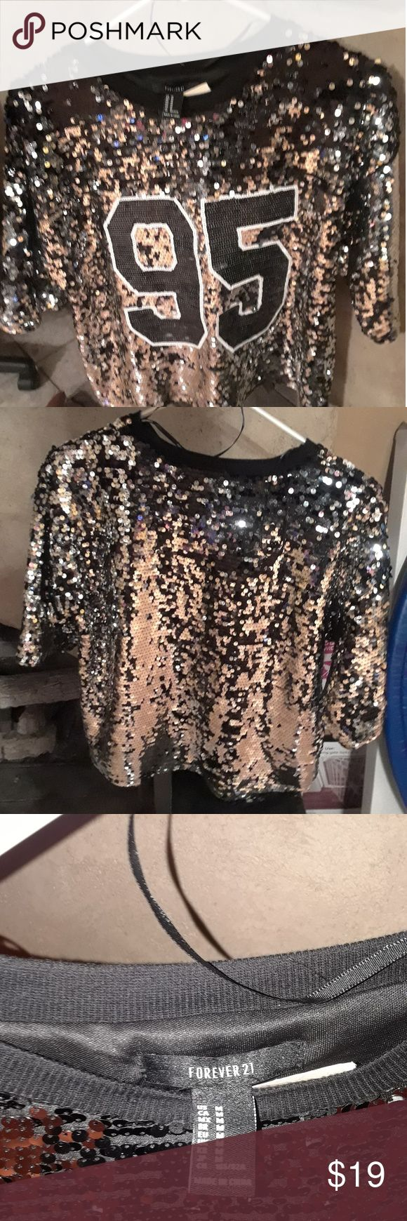 Forever 21 Silver sequin evening blouse with the number 95 in front. Brand new, never worn. Forever 21 Tops Blouses
