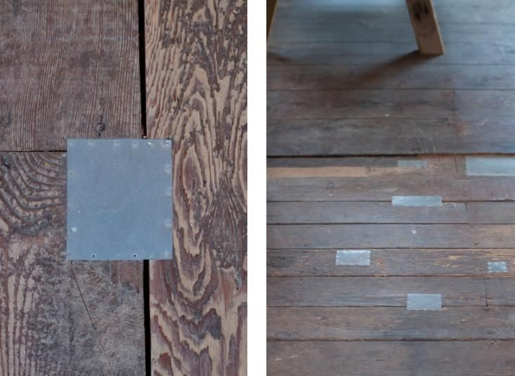 Metal patches on wood floor