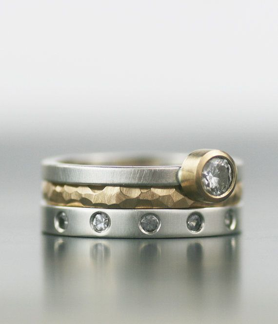 These modern, mix-and-match wedding rings are made of recycled materials and conflict-free stones.