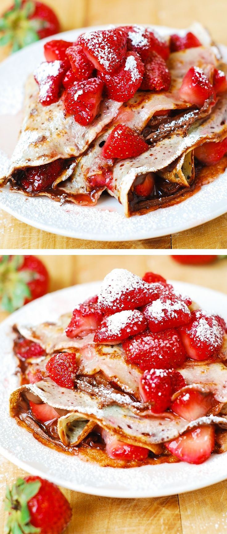 Strawberry & Nutella crepes, sprinkled with powdered sugar! Perfect for Summer breakfast or dessert!