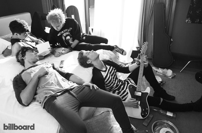 Calum Hood, Michael Clifford Luke Hemmings and Ashton Irwin of 5 Seconds of Summer photographed on June 29, 2014 at the Radisson Blu Hotel in Milan.