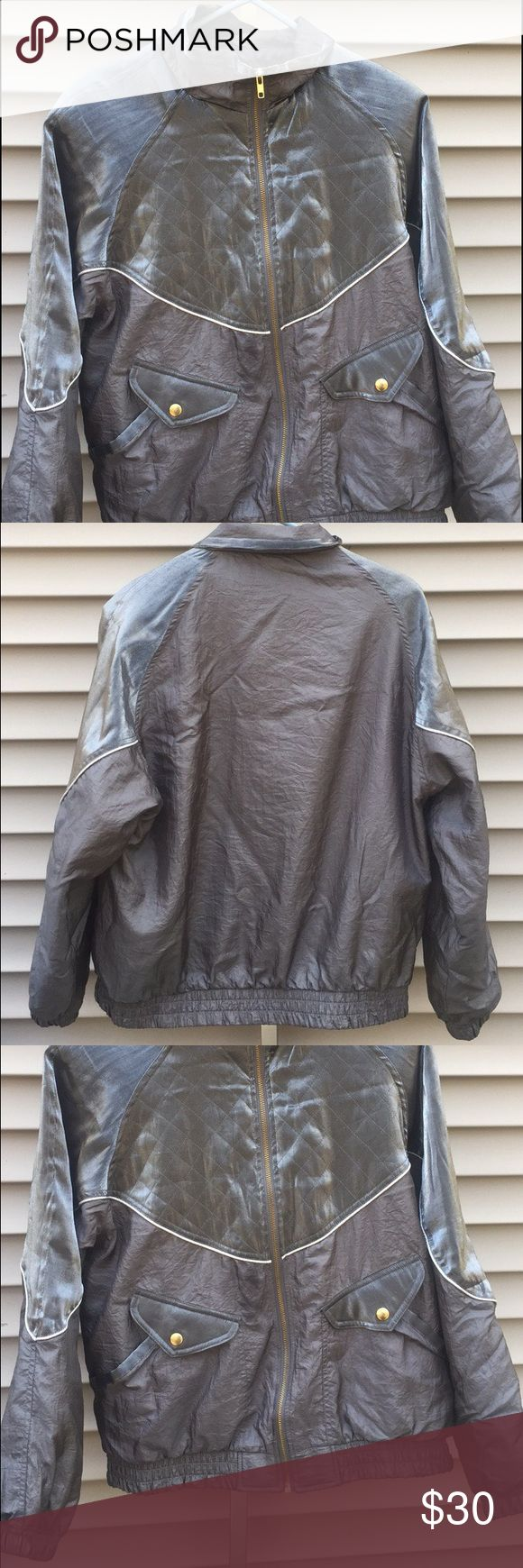 Vintage Silver Gray Windbreaker Light Jacket What a cool jacket. Different shades of gray and silver. Golden zipper. Great pockets and an elastic waist. Tagged M. Small, faint barely noticeable oil type stain on jacket near bottom of zipper.   #medium #windbreaker #windbreakers #discount #cool #fashion #cheap #lightjacket #fashionable #bundlediscount #jacket #jackets #m #silver #gray #grey #cool #vintage #vtg #unique #sport #sporty 💥30% off all bundles💥 Jackets & Coats