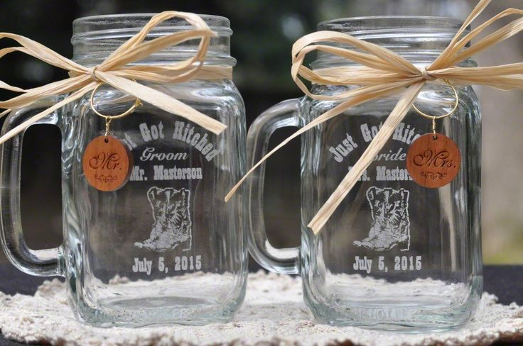 Cowboy Boot Wedding Mason Jars with Wooden Charms and Choice Handle Directions. Mr and Mrs Mason Jars with Cowboy Boot Artwork, each 16 ounces, approximately 5.25 Inches tall. Each glass will be customized with Last Name and Wedding or Engagement Date. Mr and Mrs hand finished and wire wrapped charms included. Ships with raffia and charms as pictured.