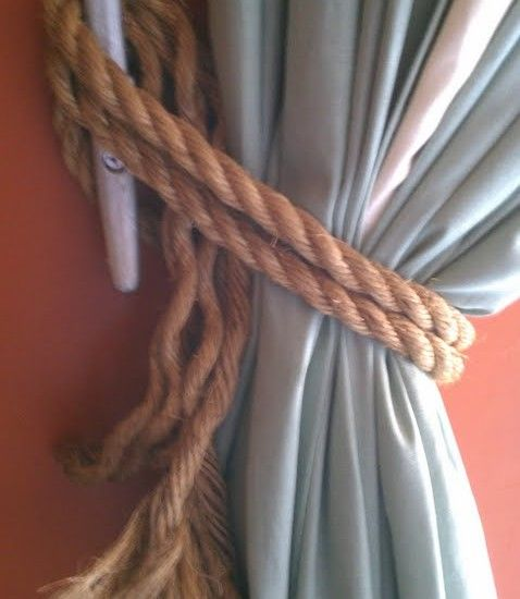 Rope and a horn cleat, perfect for his nautical/beach bedroom