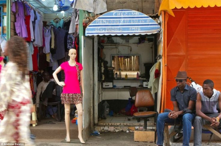 Seats one: This barbershop in Senegal, which is sandwiched between a clothes store and a vacant unit, is only big enough for one customer at a time
