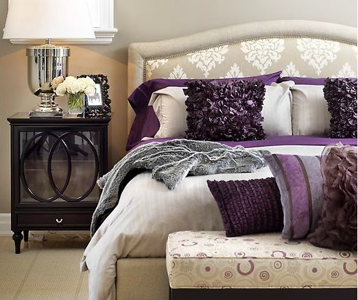 Great way to do purple-accents on a neutral ground. Great patterned headboard and purple pillows