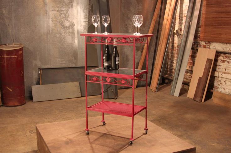 Ta-dah! Combining the tables into a stylish bar cart on wheels would have been impressive enough, but just look at that fabulous paint job!
