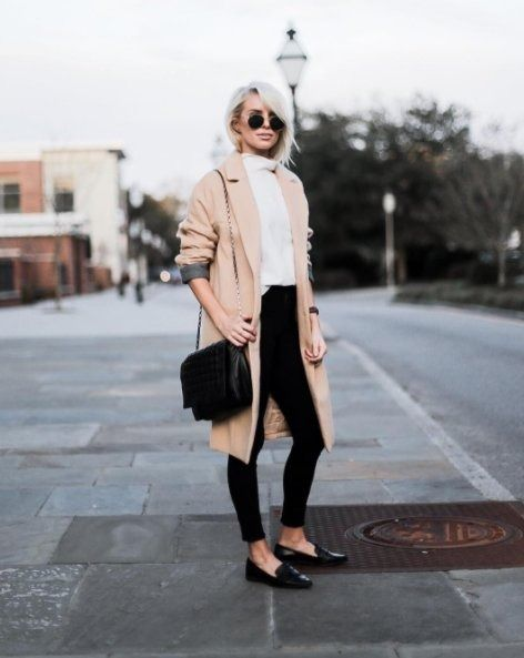 A camel coat with a sweater, slim cropped pants, and loafers.