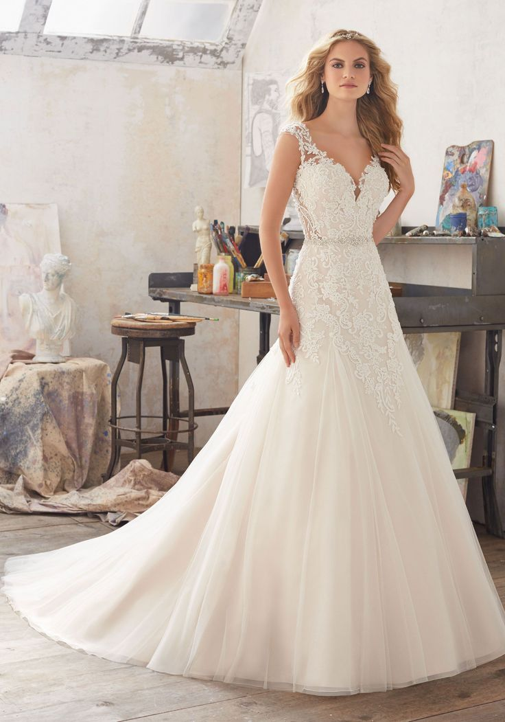 People!! Look! <3   This Fairytale Bridal Gown Features a Bodice of Crystal Beaded Alençon Lace   AppliquéŽs on Soft Tulle. Delicately Beaded Waistline and Illusion Keyhole Back.