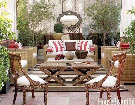 This outdoor patio designed by Thom Filicia truly feels like a room, thanks to curtains of Sunbrella fabric and a Moorish-inspired mirror that hangs from the pergola on industrial chains.   - HouseBeautiful.com