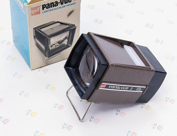 """A vintage GAF Pana-Vue 2 lighted 2x2 slide viewer in original box. It """"provides brilliant magnification of 35mm, 126 cartridge and Super Slides."""" It hasn't been tested out since we don't have any slides, but it looks in tip-top shape. - For 35mm, 126 cartridge and super slides. -"""