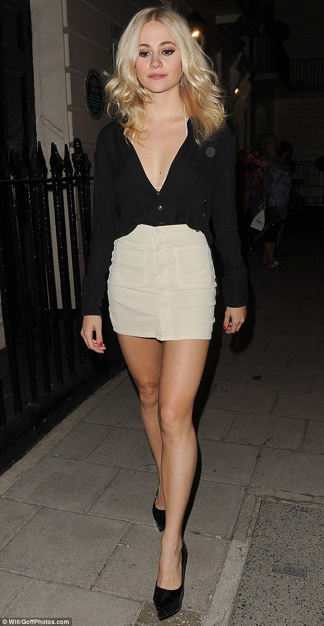 A Lott-a leg! Pixie Lott, 25,flaunted her legs and a hint of cleavage in a micro-mini ski...