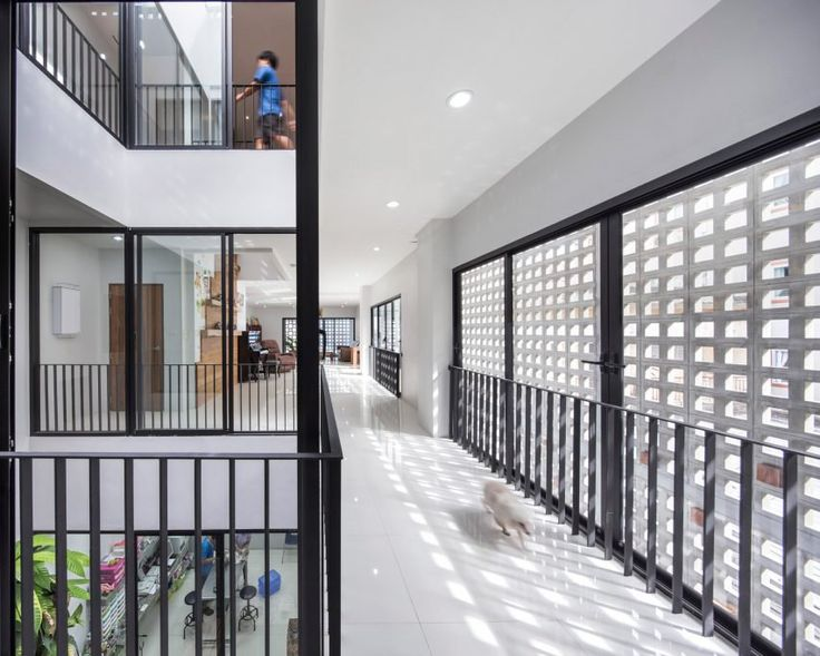 Its perforations, some of which are filled with glass blocks, also allow the artificial light to seep out at night and reveal sections of the spaces behind.
