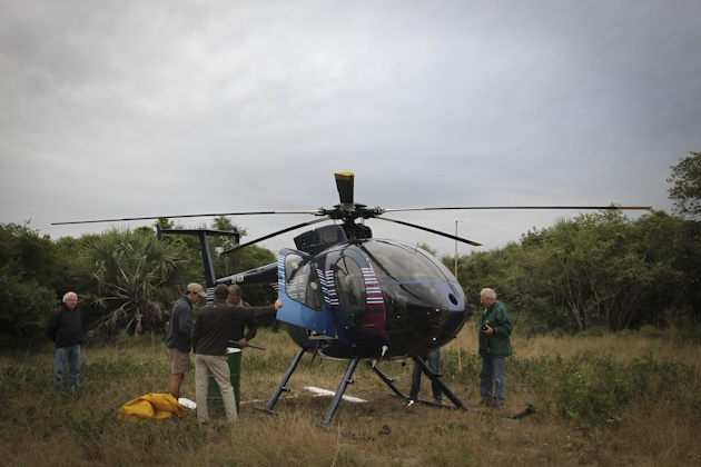 The helicopter on standby until the rhino was located. All Bonamanzi's Rhino are dehorned for their protection
